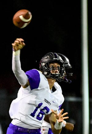 TCA's Lane Lamberth (16) throws a pass down the field in a TSSAA football game between Trinity Christian Academy at Fayette Academy in Somerville, Tenn., on Thursday, Aug. 23, 2018.