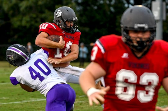 TCA's Addison Coleman (40) attempts to take down Fayette's Rube Scott Rhea (10) in a TSSAA football game between Trinity Christian Academy at Fayette Academy in Somerville, Tenn., on Thursday, Aug. 23, 2018.