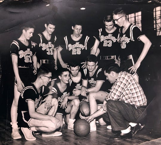 Bill Henson coaches the Panthers basketball team during his time as a coach at Powell High School.