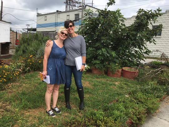 Magpies Bakery founder/owner Peg Hambright and Kimberly Pack, owner of Lucky Lawns, plan cleanup and enhancement of the garden behind the Color-Ama building for the Sept. 8 anniversary celebration. Aug. 20, 2018.