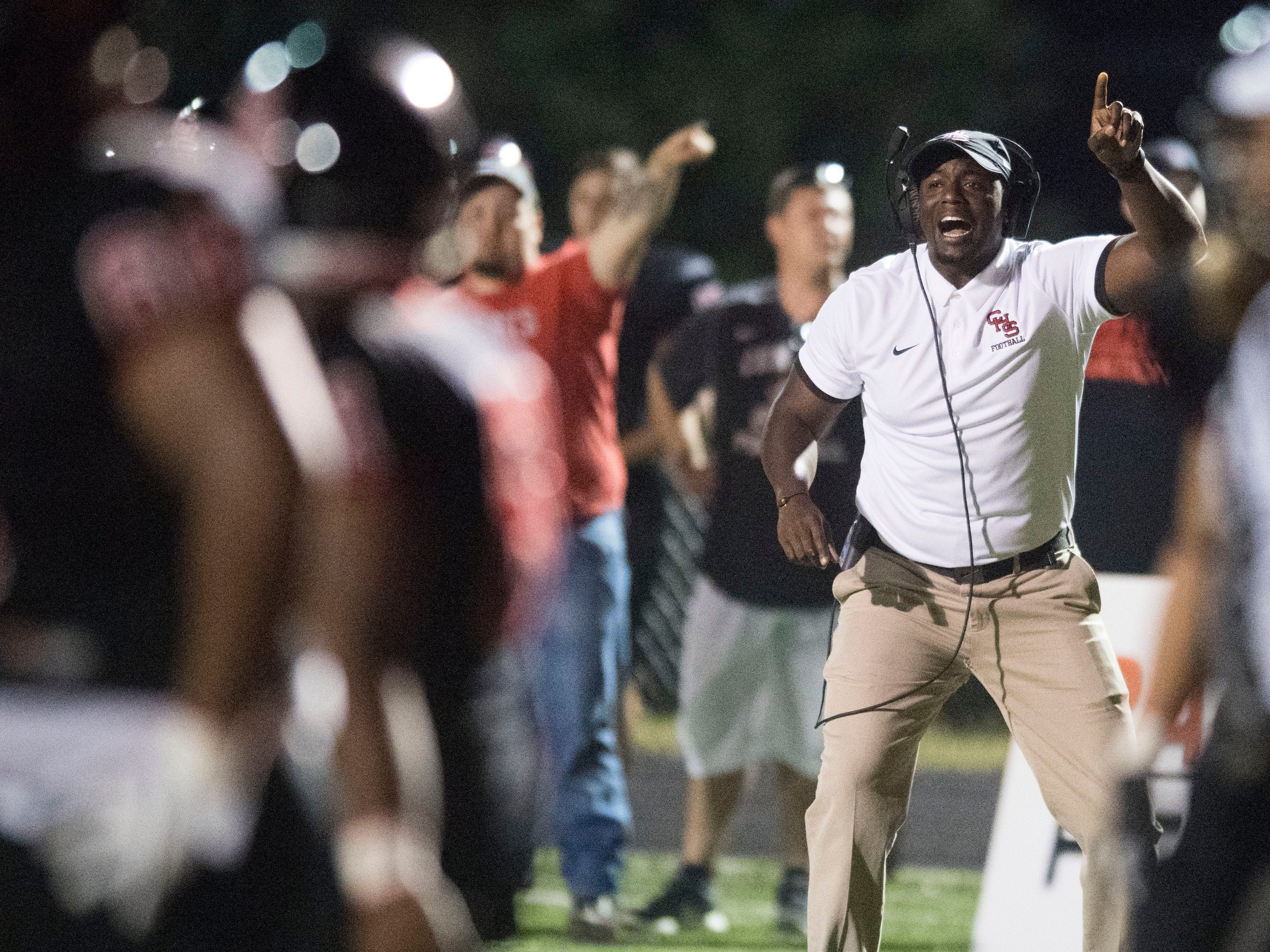 Central head coach Bryson Rosser yells out directions to his team during the football game against Fulton on Thursday, August 23, 2018.