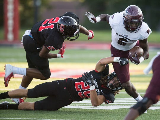 Fulton's DeShawn Page (6) is taken down by Central's Kalib Fortner (29) and Makhi Anderson (21) in the football game at Central football on Thursday, August 23, 2018.