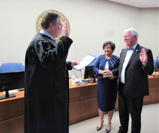 Town Judge Keith Alley administers the oath of office to Ron Williams on Aug. 23. Williams' wife, TC, holds the family Bible. 2018