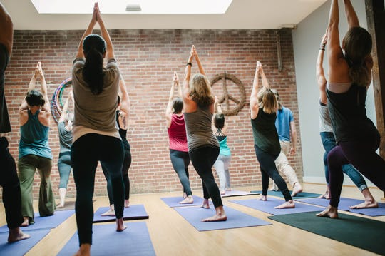 You can take advantage of free yoga classes at The Glowing Body on Friday, Sept. 7. It's all part of a 10-year anniversary celebration. Photo taken Dec. 4, 2017.