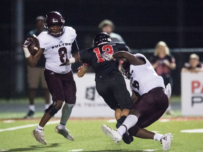 Fulton's DaShaun McKinney (8) gets an interception after DeShawn Page (6) breaks up a pass intended for Central's CJ Johnson (12) in the football game at Central on Thursday, August 23, 2018.