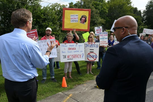 Gov. Bill Haslam stops to talk to protesters outside his first TN Ready listening tour stop at Halls Elementary School Friday, August 24, 2018.