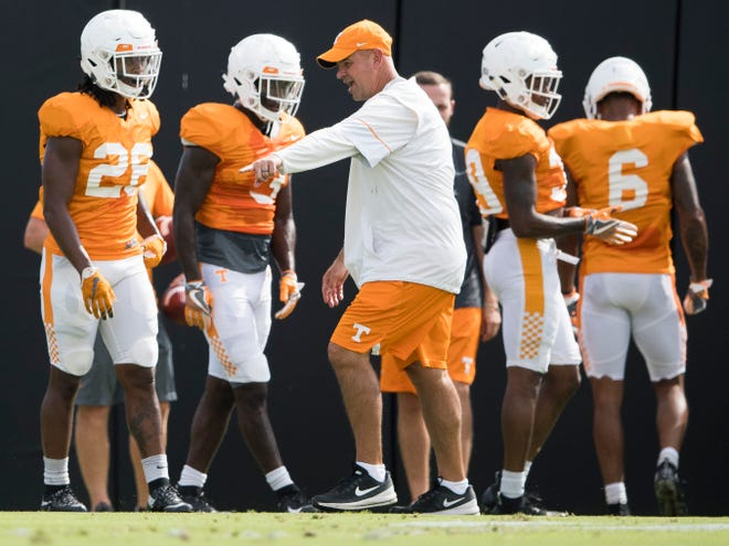 Tennessee Head Coach Jeremy Pruitt works with the defensive backs during afternoon football practice on UT's campus on Friday, August 24, 2018.
