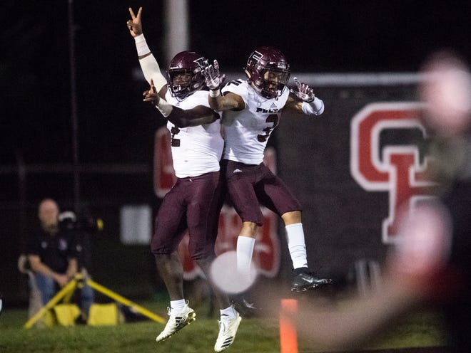 Fulton's JaShaun Fenderson (2) and Shamond Morelan (3) celebrate after Fenderson scores a touchdown in the football game against Central on Thursday, August 23, 2018.