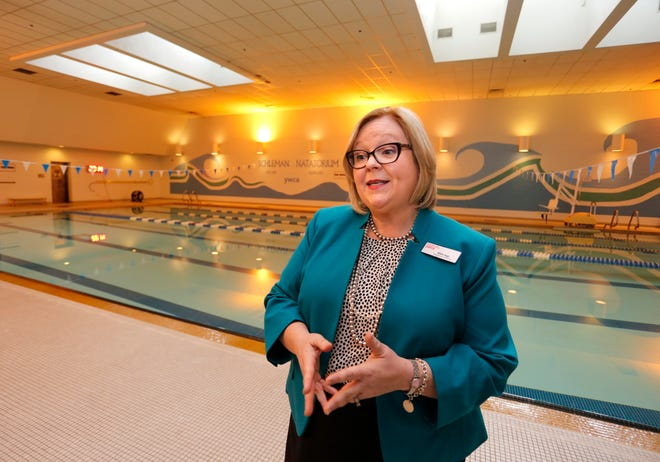 In this file photo, Allison Beggs, YWCA executive director, talks about the decision to close the YWCA Greater Lafayette pool. Beggs, who became executive director in May 2018, was honored at a retirement reception July 22, 2021.