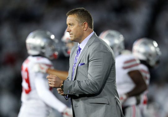 ESPN commentator Kirk Herbstreit walks on the field prior to a 2016 game between the Ohio State Buckeyes and the Penn State Nittany Lions at Beaver Stadium.
