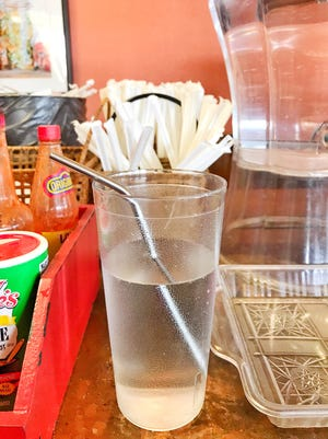 A reusable metal drinking straw.