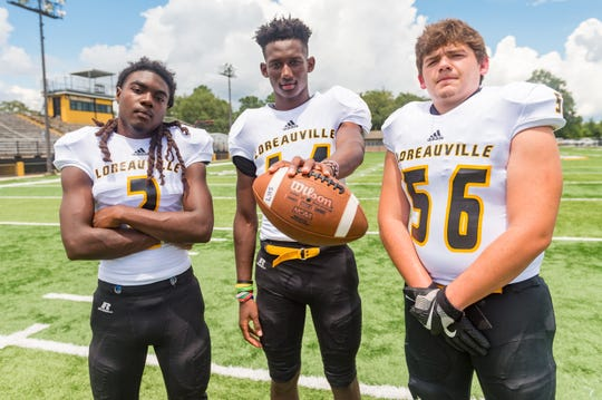 Loreauville quarterback A'Zyrian Alexander (middle), who made the All-District team last year on both offense and defense, will lead an offense that features running back Leslie Joseph (left) and offensive tackle Austin Melancon (56).