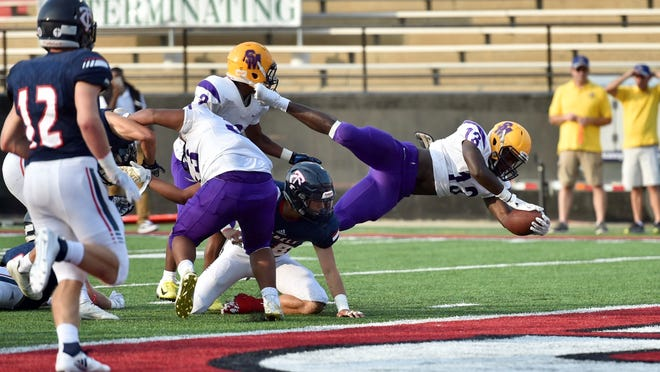 St. Martinville running back Travien Benjamin dives into the end zone during the Tigers' 14-7 victory against Teurlings Catholic in the Lafayette Kiwanis Jamboree at Cajun Field on Aug. 23, 2018.
