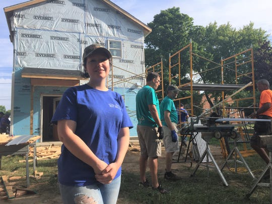Rebecca Gremore and her two children are getting excited to move into a house this fall. Habitat for Humanity volunteers install siding on the Howell home, Friday, Aug. 24, 2018.