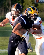 Reece Potter had Hartland's only touchdown in a 24-11 loss to Dearborn on Thursday, Aug. 23, 2018.