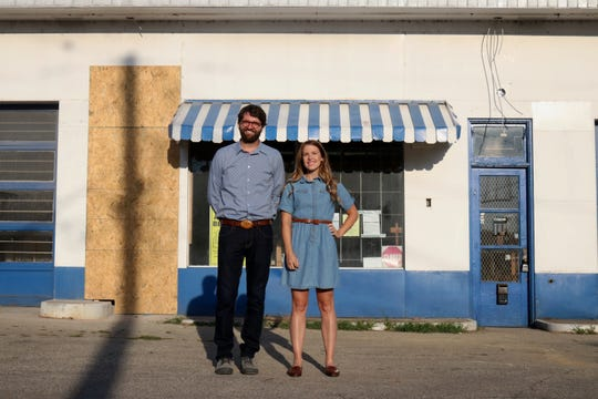 Owner Kristopher Kelley and manager Sarah Beth Welder stand in front of a Germantown building that will become the Full Stop Filling Station, 1132 E. St. Catherine St.