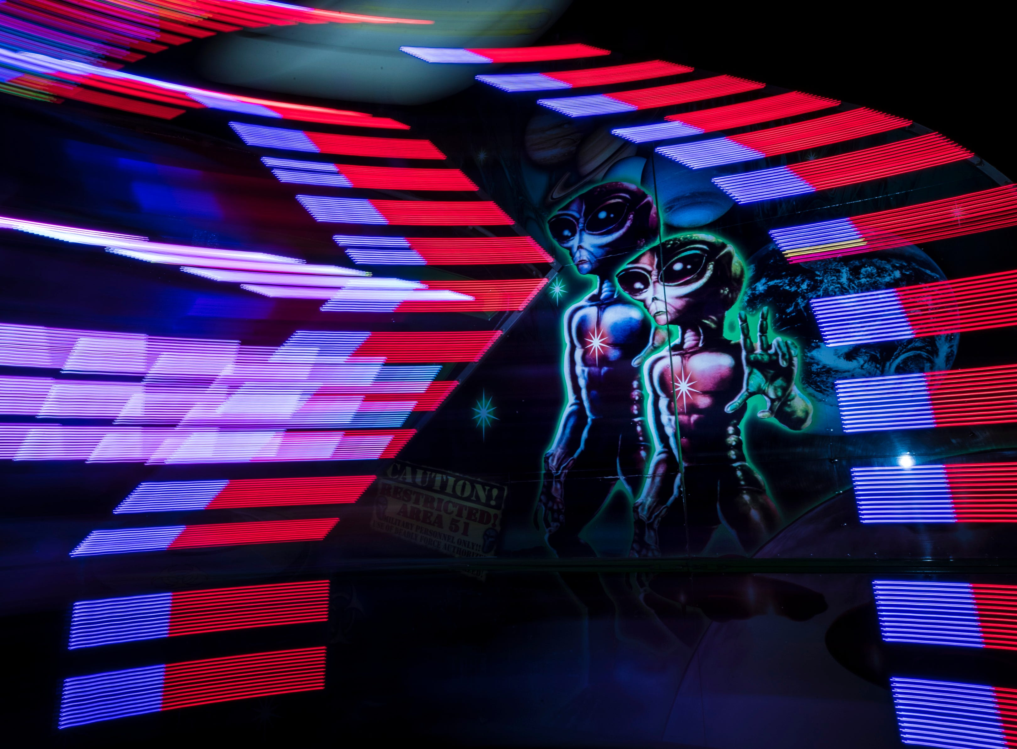 An alien mural on the Area 51 ride at the Kentucky State Fair midway on Thursday evening. Aug. 24, 2018