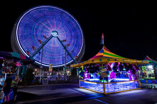 A Ferris wheel is on display at the 2018 Kentucky State Fair. Because of restrictions and social distancing requirements because of the coronavirus pandemic, this year's fair is expected to draw about half of the usual 500,000 visitors.