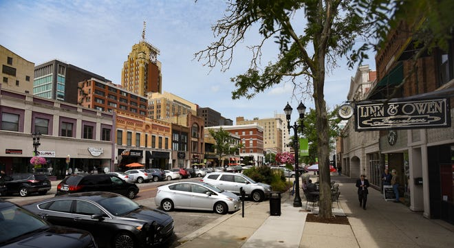 Downtown Lansing on S. Washington Square near W. Washtenaw St., Friday, Aug. 24, 2018. With the addition of Shiawassee County in the Lansing-East Lansing Metropolitan Statistical Area, the Lansing region isnow home to more than a half million people.