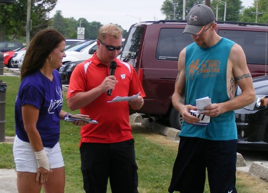Ascend Services, Inc., hosted its 5K Run, Walk & Roll Aug. 18 on Mariners Trail. From left are Manitowoc Mayor Justin Nickels, Ascend Director Deanna Genske and winner Kory Richardson.