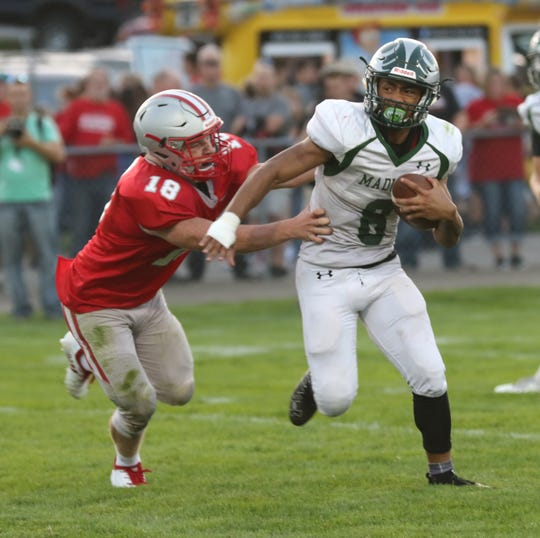 Madison's Ian McGregor avoids a Shelby player on Thursday.