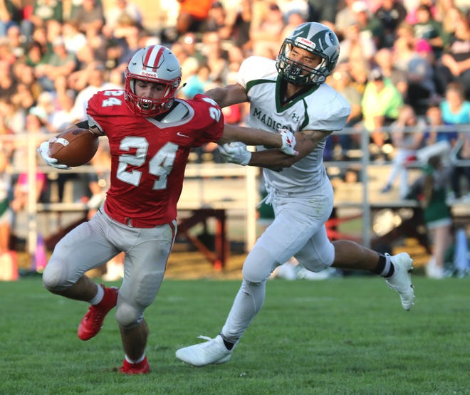 Shelby's Owen Fisher, shown here outmaneuvering Madison's J.B. Atkins during last year's season opener, returns after running for728 yards and eight touchdowns as a sophomore.
