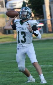 Madison's Kaden Mullins makes a pass while playing at Shelby in Week 1.