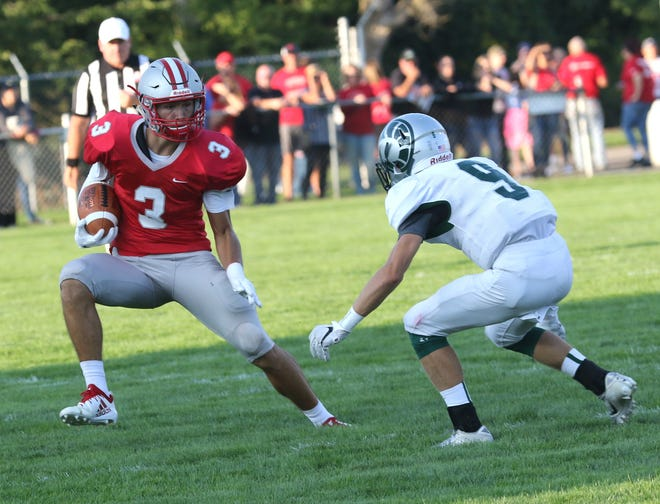 Shelby's Uriah Schwemley runs with the ball on Thursday.