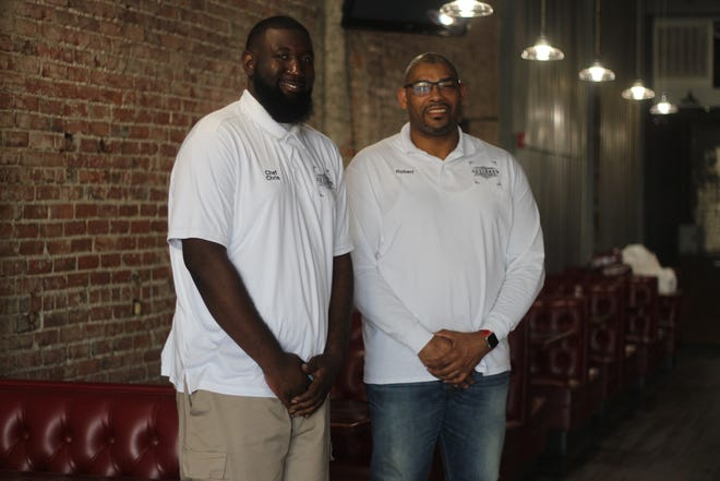 Co-owners Chris Rennick, left, and Robert Turner, right, open their new comfort cuisine restaurant Attaboy's Monday in downtown Marion.
