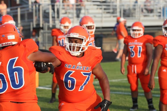 Southaven's Kahlil Benson goes through pregame warmups before Friday's home game against Olive Branch on Aug. 24, 2018.