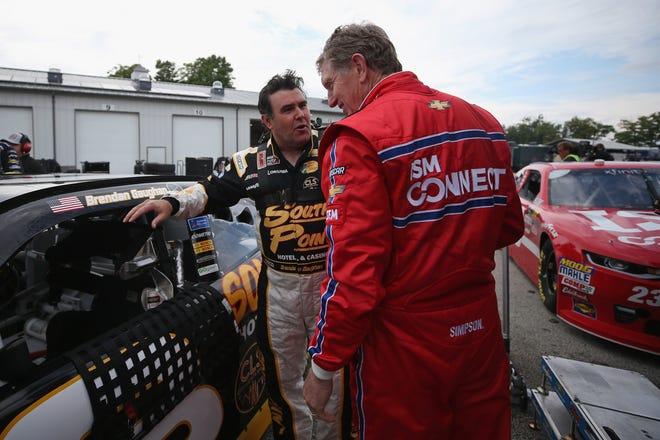 Brendan Gaughan, left, and Bill Elliott talk during Xfinity Series practice Friday at Road America. Elliott is making a one-race return to NASCAR for the Johnsonville 180.