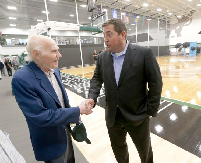 Former Milwaukee Bucks owner Herb Kohl (left) shakes hands with Milwaukee Bucks president Peter Feigin on Sept. 25, 2017, during a media day at the new Froedtert & the Medical College of Wisconsin Sports Science Center on North 6th Street.