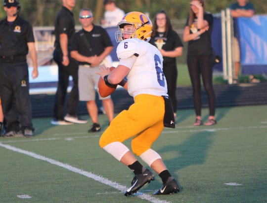 Oconomowoc quarterback Brady Wraalstad winds up to fire a pass downfield against Brookfield Central on August 23.