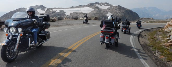 Riders make U-turns near the summit on the Beartooth Scenic Byway in Wyoming on Aug. 23.