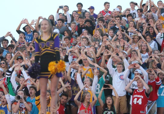 Oconomowoco students hold up an 'O' symbol with their hands before a kick-off against Brookfield Central on August 23.