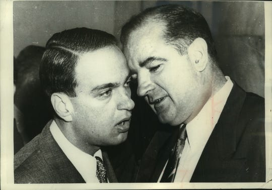 The late Senator Joseph McCarthy (right) whispered to Roy Cohn at the height of the Army-McCarthy hearings in Washington.