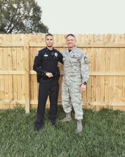 Alejandro Garrido was a police officer with the West Melbourne Police Department in Brevard County, Florida, for about a year and half before an injury derailed his career. He poses with his father, Benjamin Garrido.