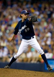 John Axford found some success as a reliever for the Brewers.