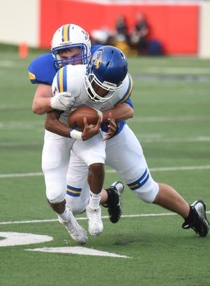 Mountain Home's Matt Jones brings down Sheridan quarterback Stephon Thomas for a loss.