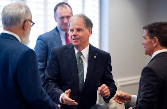 Senator Doug Jones arrives for a listening session on possible Medicaid expansion and other medical cost issues at the Alabama Hospital Association in Montgomery, Ala., on Friday August 24, 2018.