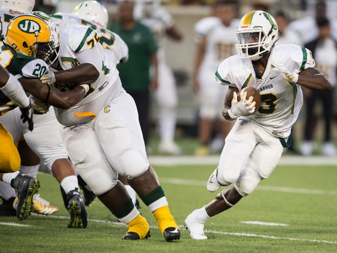 Carver's Terrance Webster (3) runs around his line against Jeff Davis at Hornets Stadium in Montgomery, Ala., on Thursday, Aug. 23, 2018. Carver leads Jeff Davis 19-3 at halftime.