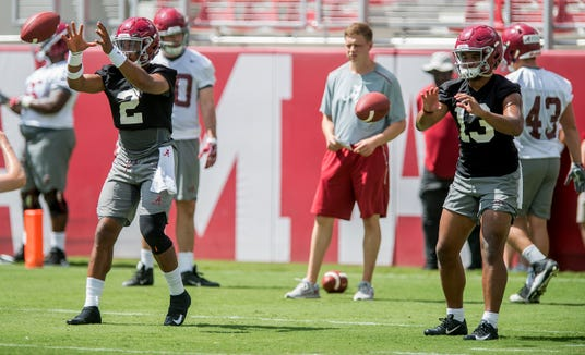 Quarterbacks Jalen Hurts (2) and Tua Tagovailoa (13) take snaps side by side as the University of Alabama football team holds practice in Bryant-Denny Stadium on the Alabama campus in Tuscaloosa, Ala. on Saturday August 4, 2018.