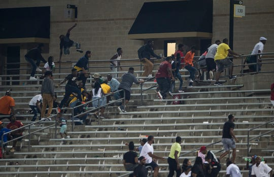 Carver fans make their way to the exit after hearing gun shots at ASU Stadium in Montgomery, Ala., on Thursday, Aug. 23, 2018. A shooting outside the stadium ended the game with 11 minutes left in the fourth quarter Carver winning 19-3 over Jeff Davis.