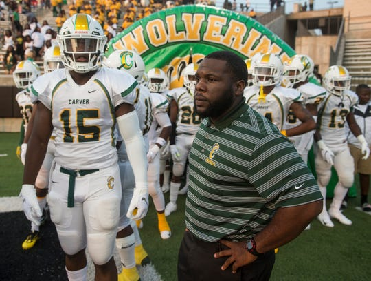 Carver head coach James Thompson leads his team out onto the field before taking on Jeff Davis at ASU Stadium in Montgomery, Ala., on Thursday, Aug. 23, 2018. A shooting outside the stadium ended the game with 11 minutes left in the fourth quarter Carver winning 19-3.