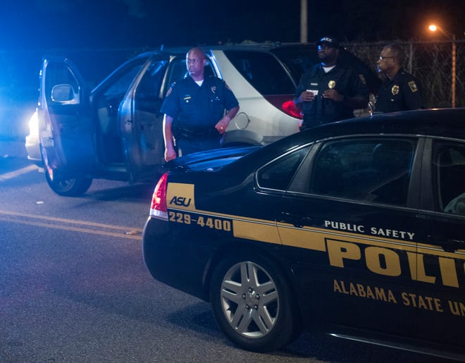 Police investigate a shooting on Pineleaf Road outside ASU stadium Stadium in Montgomery, Ala., on Thursday, Aug. 23, 2018.