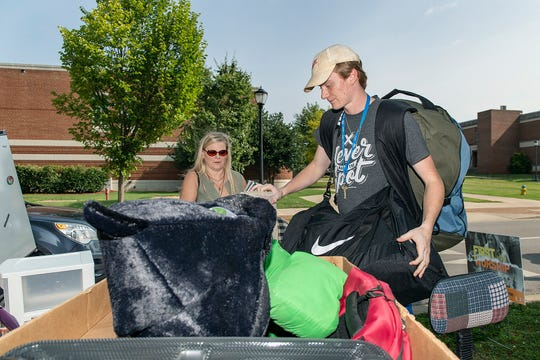 MTSU students and their famililes descended on campus Friday, Aug. 24, during the We-Haul move-in at Corlew Hall and other campus residence halls. Volunteers helped hundreds of students get settled into their dorms in preparation for the start of fall semester Monday, Aug. 27.