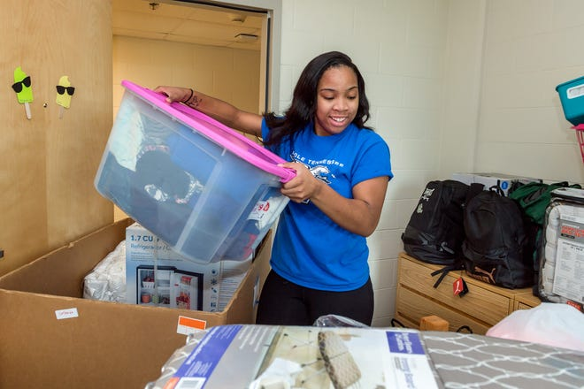 Jada Sims unpacks her belongings as she moves into her dorm room at MTSU on Friday, Aug. 24, 2018.