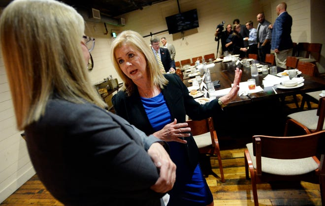 U.S. Rep. Marsha Blackburn talks with Tennessee Farm Bureau Executive Vice President Rhedona Rose before speaking to members of the agriculture community Aug. 24, 2018, in Nashville. Blackburn is the Republican candidate in the U.S. Senate race.