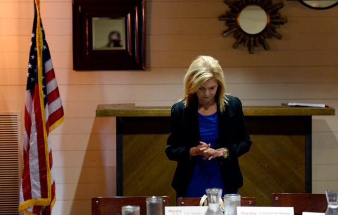 U.S. Rep. Marsha Blackburn prays before speaking to members of the agriculture community Aug. 24, 2018, in Nashville. Blackburn is the Republican candidate in the U.S. Senate race.
