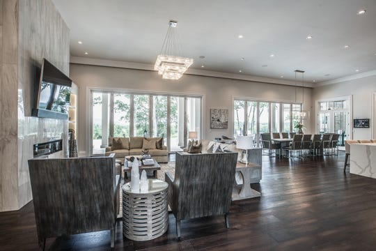 The living, dining and kitchen areas are all open for entertaining, with an 18-foot folding wall of glass that folds back to allow the space to flow onto the home's covered patio.